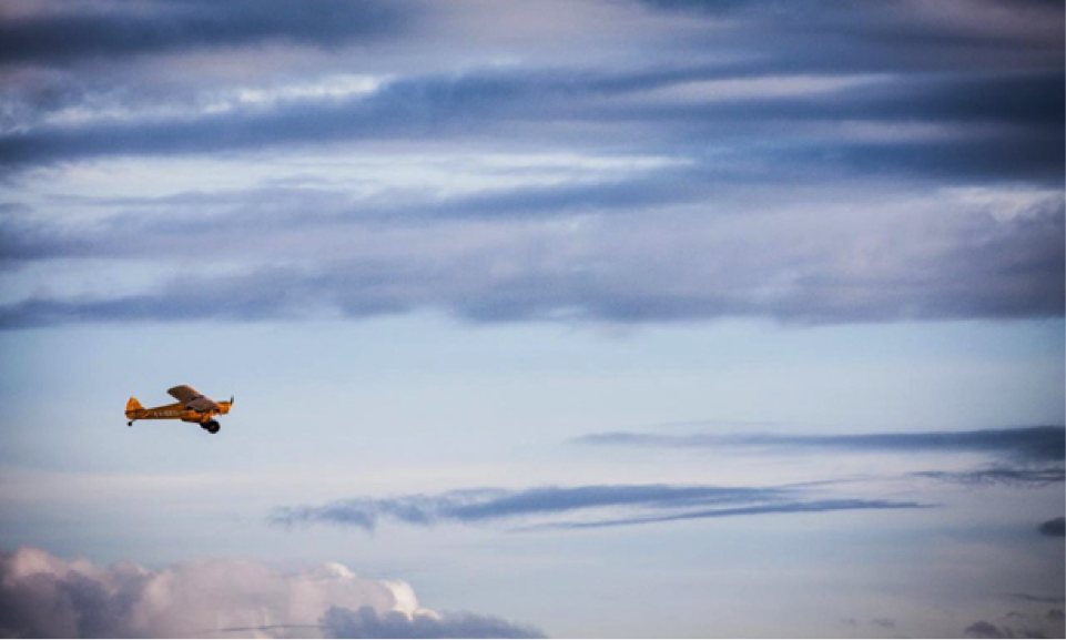 Bi-plane in blue sky