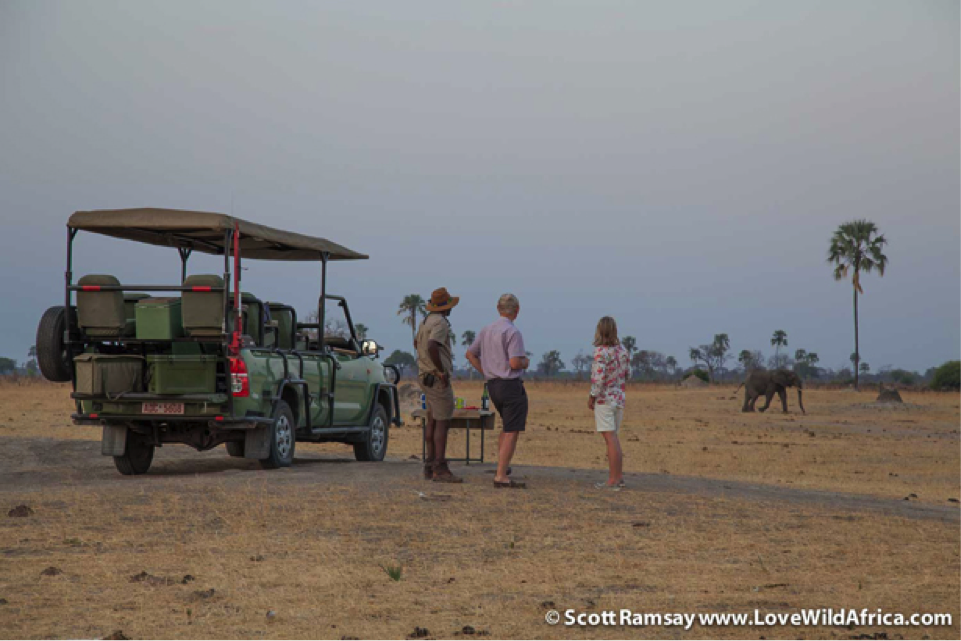 Sundowners with guests at a pan near Linkwasha as the elephants come to drink